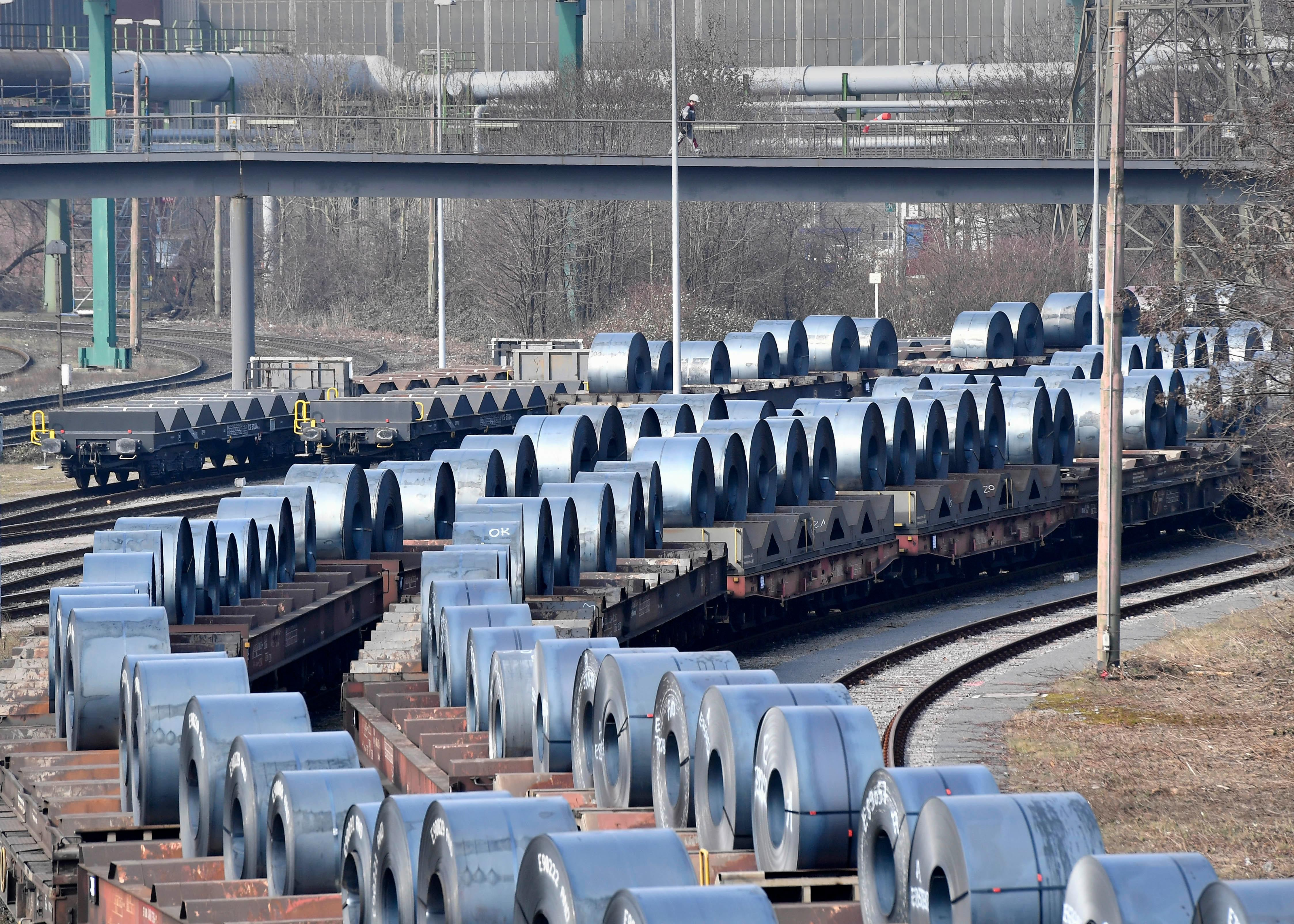 Steel coils sit on wagons when leaving the thyssenkrupp steel factory in Duisburg Germany & White House: No exemptions from steel aluminum tariffs